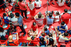 Fans waiting for Joseph Schooling, the Singapore's first Olympic gold medalist, at Raffles City. August 18, 2016. Crowd waiting with colourful banners to get stock image