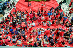 Fans waiting for Joseph Schooling, the Singapore's first Olympic gold medalist, at Raffles City. August 18, 2016. Crowd waiting with colourful banners to get stock images