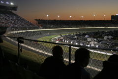 Fans watch the driver pre-race. A night time view  of pre-race activities from turn 2 during the Bank of America 500, October 2007  at Lowes Motor Speedway in Royalty Free Stock Photo