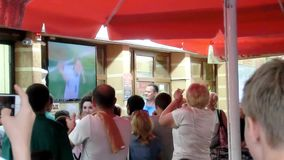 Fans watch the World Cup in the cafe stock video footage