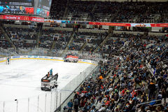 Fans watch Zambonis clean the ice Royalty Free Stock Images
