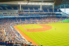 Fans watching a baseball game at the Miami Marlins Stadium. MIAMI, USA - JUNE 1,2014 : The Miami Marlins play the Atlanta Braves in a game of the Eastern Royalty Free Stock Photography
