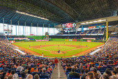 Fans watching a baseball game at the Miami Marlins Stadium. MIAMI, USA - JUNE 1,2014 : The Miami Marlins play the Atlanta Braves in a game of the Eastern Stock Photo