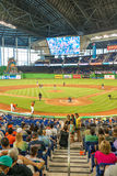 Fans watching a baseball game at the Miami Marlins Stadium. MIAMI, USA - JUNE 1,2014 : The Miami Marlins play the Atlanta Braves in a game of the Eastern Stock Image