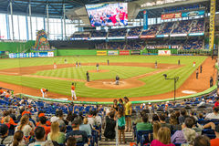 Fans watching a baseball game at the Miami Marlins Stadium. MIAMI, USA - JUNE 1,2014 : The Miami Marlins play the Atlanta Braves in a game of the Eastern Stock Images