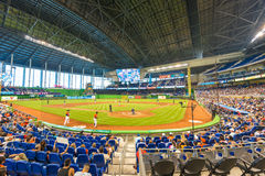 Fans watching a baseball game at the Miami Marlins Stadium. MIAMI, USA - JUNE 1,2014 : The Miami Marlins play the Atlanta Braves in a game of the Eastern Royalty Free Stock Photo