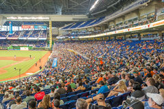 Fans watching a baseball game at the Miami Marlins Stadium. MIAMI, USA - JUNE 1,2014 : The Miami Marlins play the Atlanta Braves in a game of the Eastern Stock Photography