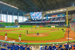 Fans watching a baseball game at the Miami Marlins Stadium. MIAMI, USA - JUNE 1,2014 : The Miami Marlins play the Atlanta Braves in a game of the Eastern Royalty Free Stock Images