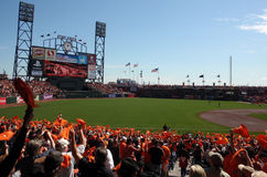 Fans wave orange towels, pump up team before game Stock Photo