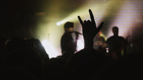 Fans waving their hands. Crowd partying at a concert or a night club. Royalty Free Stock Photography