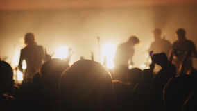 Fans waving their hands at a rock concert. Crowd partying at a concert. Royalty Free Stock Images