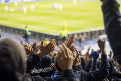 fans who clap their hands at the stadium Royalty Free Stock Photo