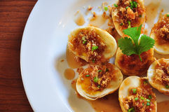 Fansy eggs dish. Thai fansy eggs dish called Kai-Look-Keoy topping with tamerind sauce stock photography