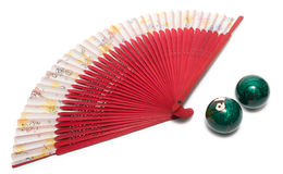 Fantail and chinese health balls Stock Photography