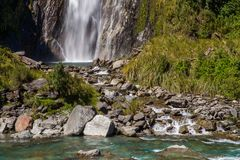 Fantail Falls. Runoff From Fantail Falls Discharging Into Haast River, Mount Aspiring National Park, West Coast, South Island, New Zealand royalty free stock image