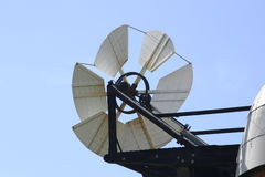 Windmill fantail with blue sky Stock Images