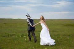 Fantaisie sur un thème/mariée et un chevalier de mariage Images stock