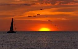 Fantasía de la puesta del sol del velero Foto de archivo libre de regalías