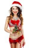 fantasía Doncella feliz de la nieve en ropa interior roja con el regalo - árbol de Navidad Fotos de archivo libres de regalías
