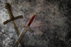 Fantasía de las espadas del Grunge Fotografía de archivo