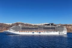 Fantasia cruise ship near Santorini island in Aegean sea Royalty Free Stock Photography