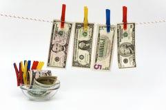 Fantasie met wasknijpers en bankbiljetten Royalty-vrije Stock Afbeeldingen