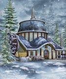 Fantasiemühle in einem Winterwald Stockfotografie
