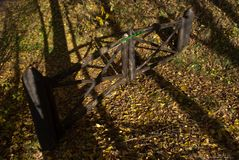 A gate in the woods. The fantasies and colors of autumn on the beautiful Dolomites stock image