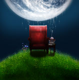 Fantasifåtölj under en stor måne Royaltyfri Foto