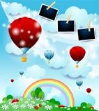Fantasilandskap med ballonger för varm luft och fotoramar arkivbilder