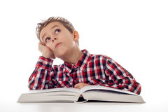 Fantasizing boy with book Royalty Free Stock Photography