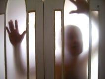 Fantasma através da porta Fotografia de Stock Royalty Free