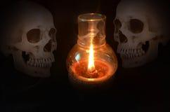 Fantasmas e luz da vela da cera Imagem de Stock