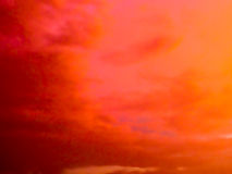 Fantastic abstract red color of twilight cloud and sky. Evening stock image