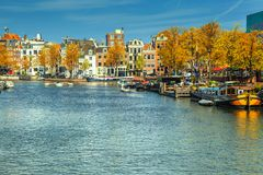 Fantastic Amsterdam canals with boats and harbors, Netherlands, Europe royalty free stock photo