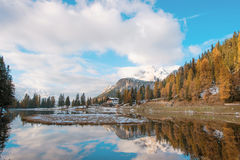 Fantastic autumn landscape with yellow larch on a background of. Snowy mountains in the Antorno Lake, Dolomites. The Italian Alps. Meditation, anti-stress Stock Photo