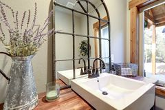 Fantastic bathroom boasts a country style wooden washstand royalty free stock images