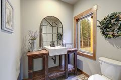 Fantastic bathroom boasts a country style wooden washstand stock photo