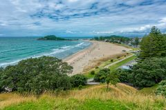 Taurang, New Zealand - January 15, 2018: Beach in Mount Maunganui with hawkes bay stock photo