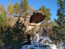The fantastic big rock in the autumn forest. Royalty Free Stock Photography