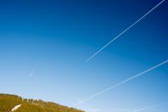 Fantastic Blue sky with clouds and traces of planes Royalty Free Stock Photo