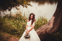 Fantastic bride with flowers Stock Photography
