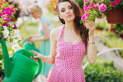 Fantastic brunette cutie in the garden Stock Photos