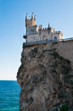 Fantastic castle on a rock Royalty Free Stock Image