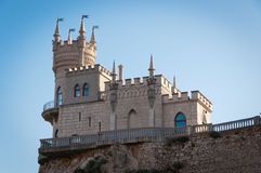 Fantastic castle on a rock Stock Photography