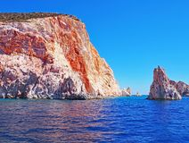 The cliffs and rock formations of Polyaigos, an island of the Greek Cyclades. Fantastic cliffs and rock formations rise from the crystal blue sea on Polyaigos stock images