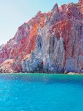 The cliffs and rock formations of Polyaigos, an island of the Greek Cyclades. Fantastic cliffs and rock formations rise from the crystal blue sea on Polyaigos royalty free stock images