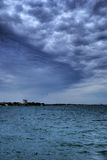 Fantastic clouds above ocean Royalty Free Stock Image