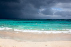 Fantastic clouds contrast on caribean beach Stock Images