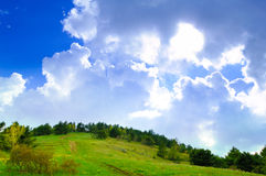 Fantastic Cloudy Sky over the Forest and Hill Royalty Free Stock Photography